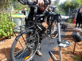 Tim fixing Radmilla - Cycling Across Australia